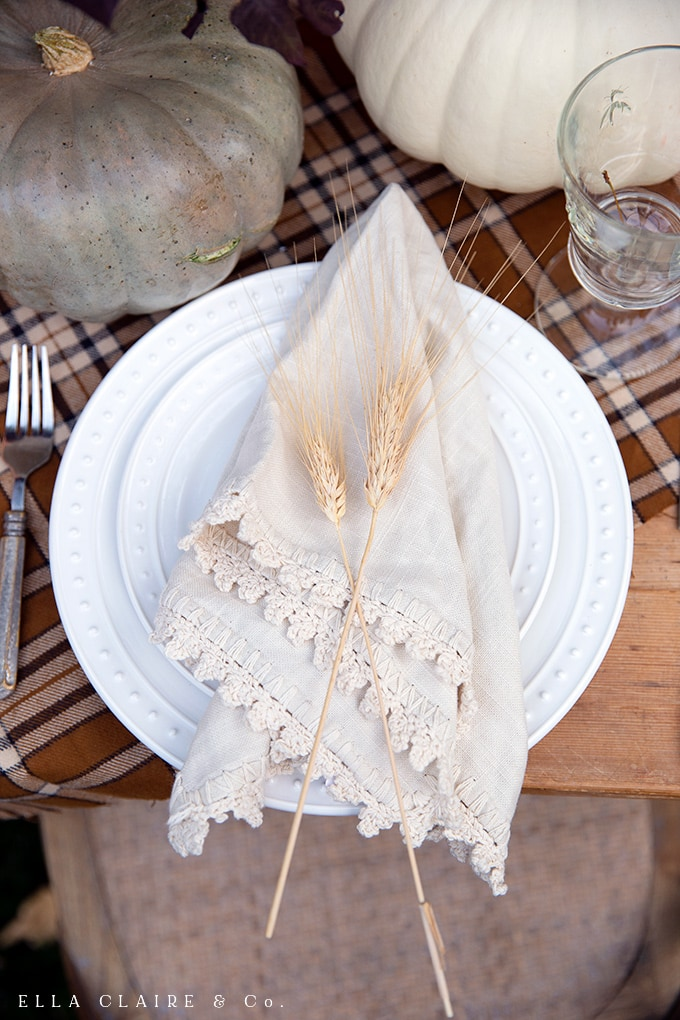 a sprig or two of wheat adds a charming touch to a fall table setting.