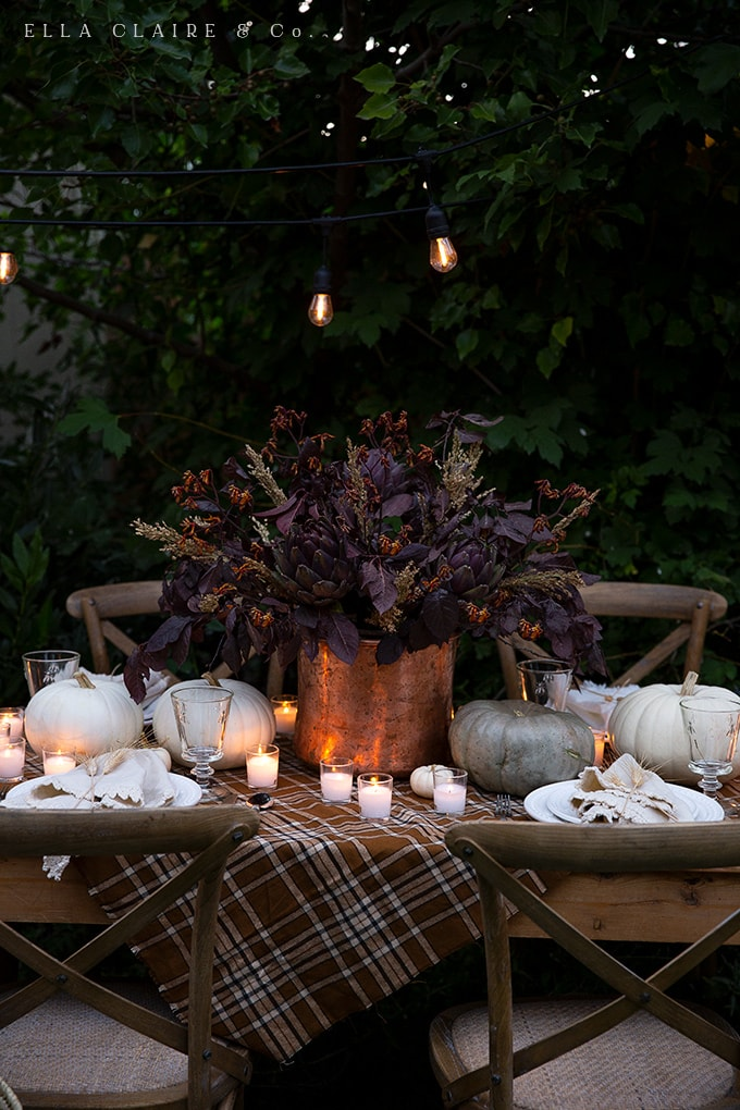 copper, rich warm tones, autumn colors and beautiful candlelight make for an inviting tablescape for autumn entertaining