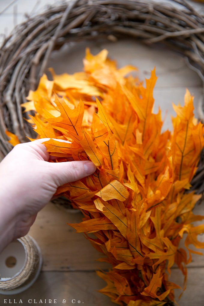 Fluffing the preserved fall leaves is an important step to making a beautiful, full autumn wreath.