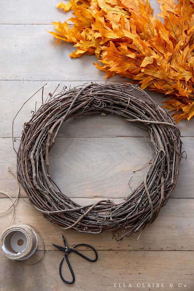 Start with a basic grapevine wreath to act as the base of the fall leaf wreath