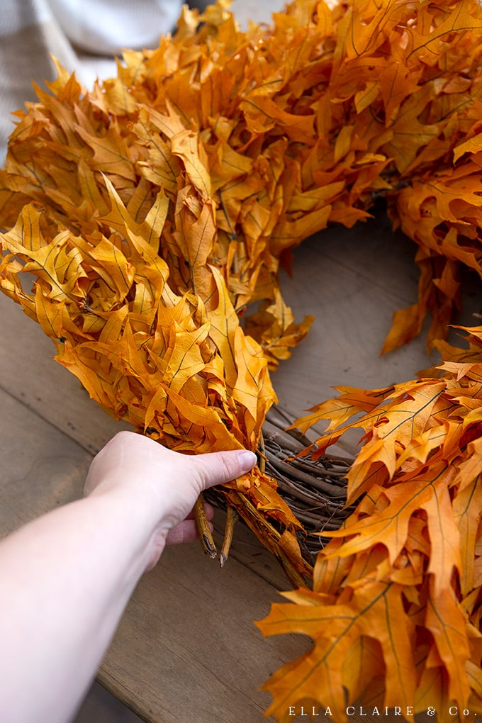 How to finish off a DIY fall wreath in an easy and inexpensive technique.