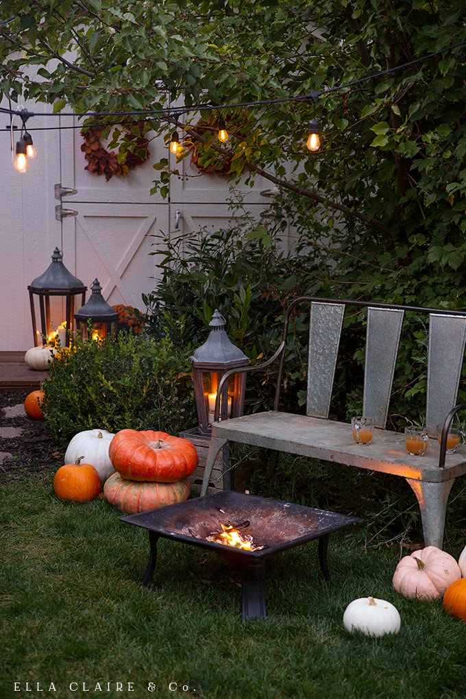 candles, lanterns, and heirloom pumpkins create a perfect fall setting for a cozy evening outdoors with the family.