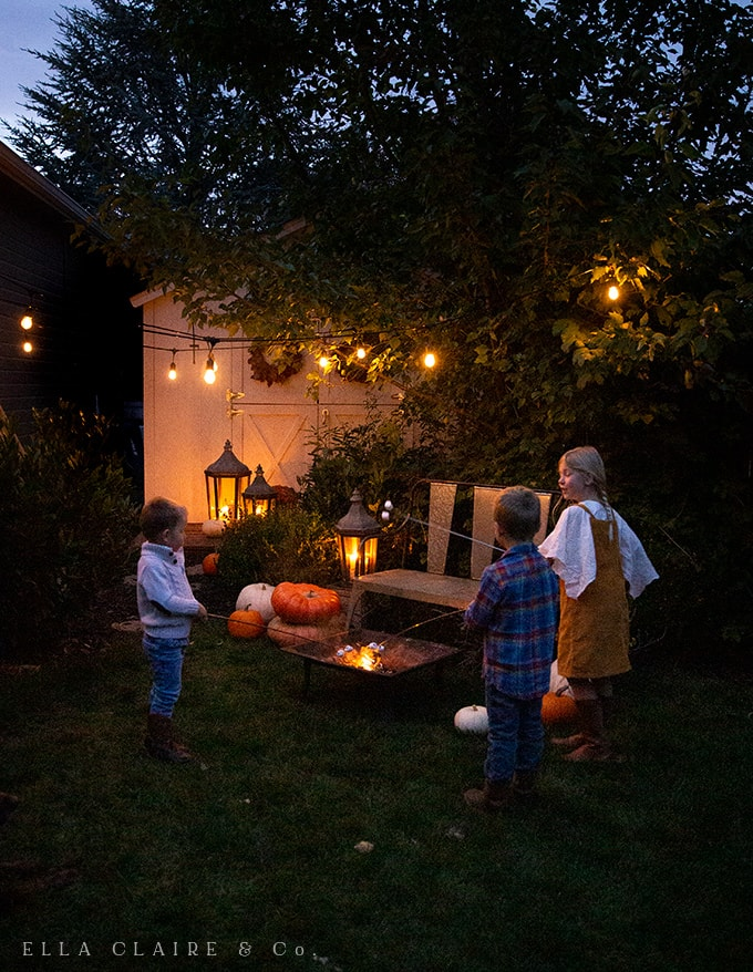 campfire with the kids roasting marshmallows in the cozy fall setting