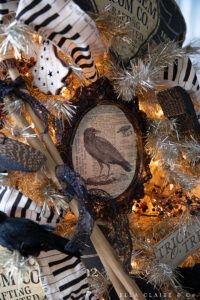 book page crow details on a vintage halloween tree