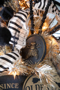 Details of a vintage halloween tree- a tinsel tree with black and cream accents