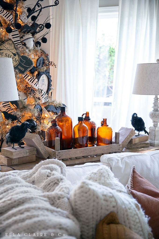 Amber glass bottles accent this cozy vintage halloween home tour
