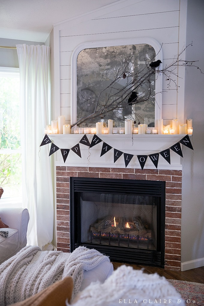 "Free printable ""Happy Halloween Banner"" in a spooky vintage halloween home tour complete with romantic and elegant ambiance, a whimsical Halloween tree, and other cozy accents."