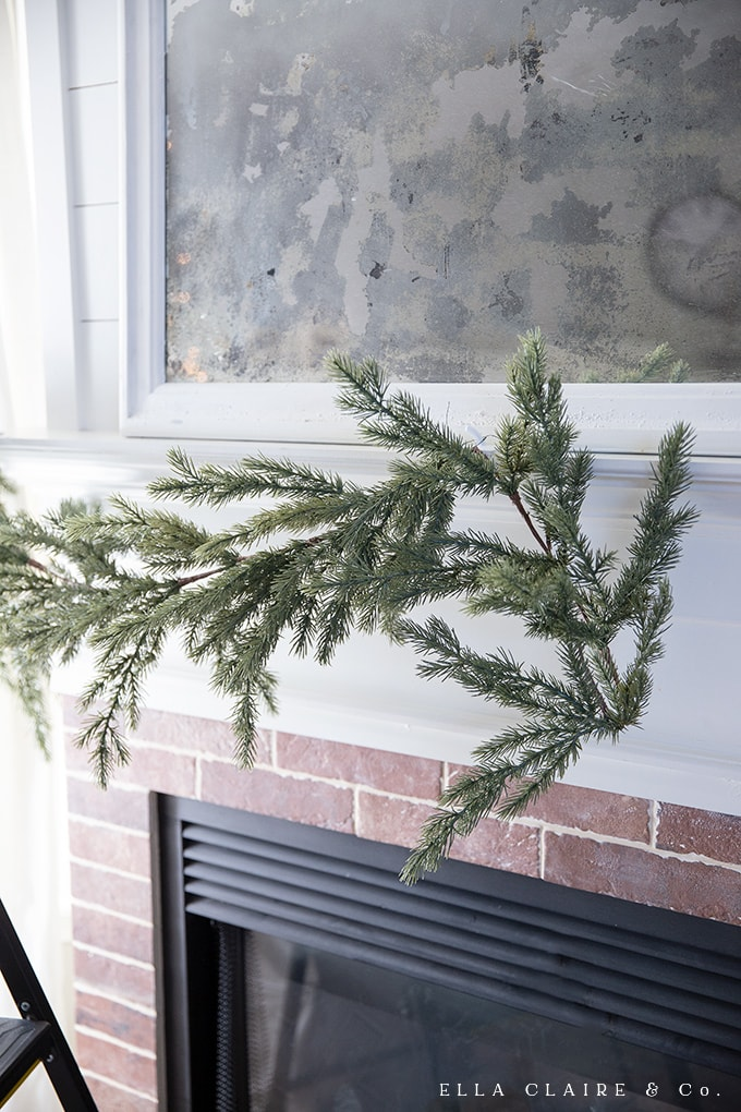 DIY lush and full Cascading garland using a faux garland base and adding greenery- a long lasting, all-season, beautiful Christmas garland.