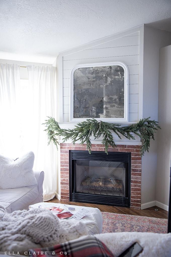 DIY lush and full Cascading garland using a faux garland base and adding greenery- a long lasting, all-season, beautiful Christmas garland.