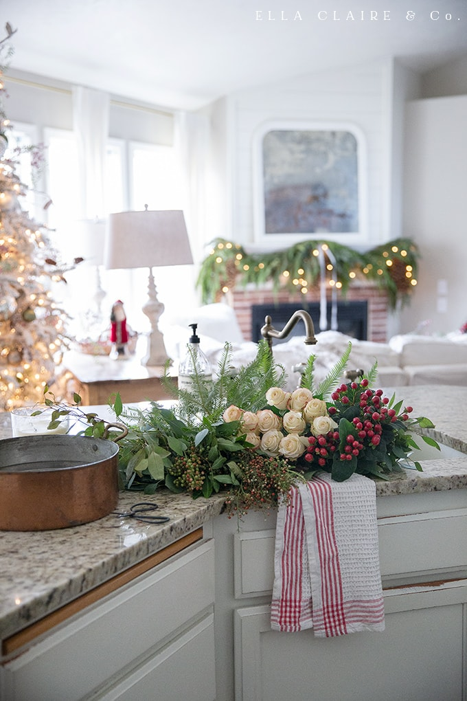 The view of the Christmas fireplace mantel from the kitchen