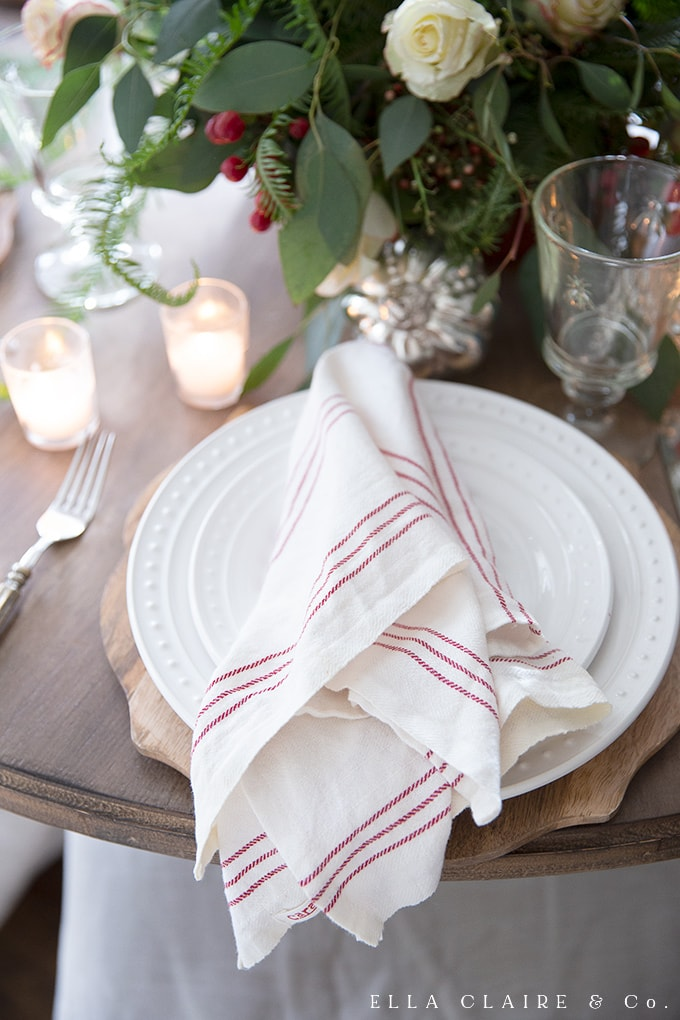 red striped napkins accent a traditional colored Christmas tablescape