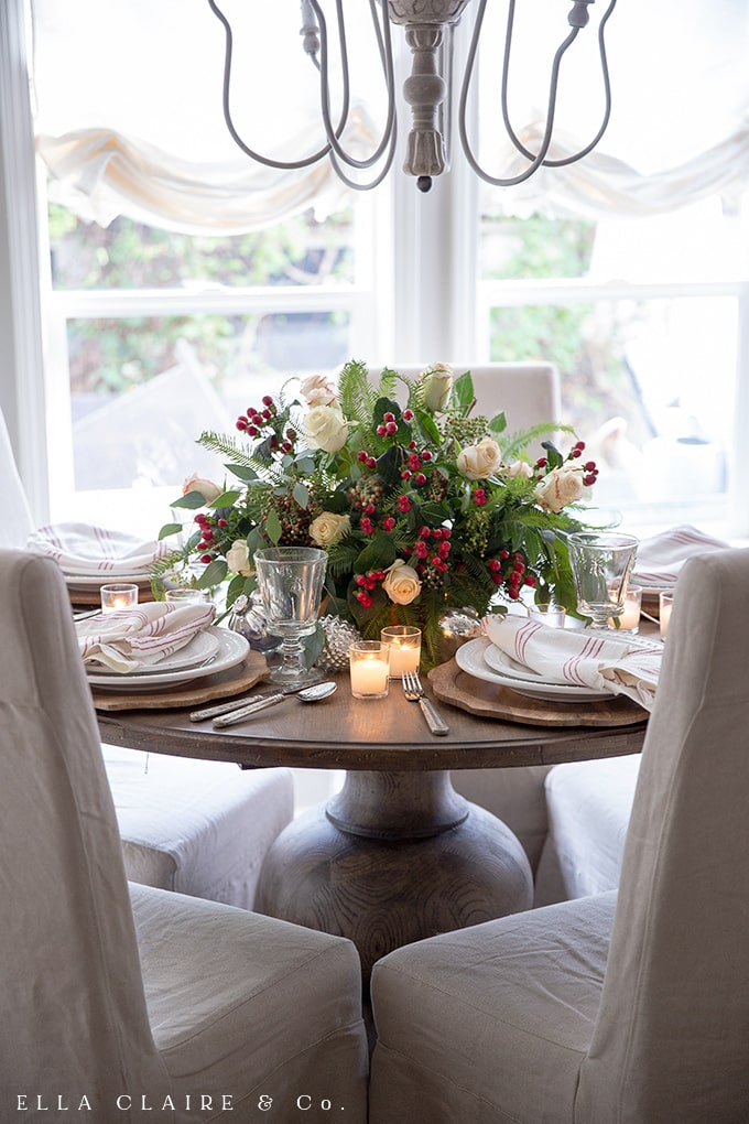 A very easy to make Christmas centerpiece with red, white and green flower arrangement, cozy candlelight, and a French chandelier.