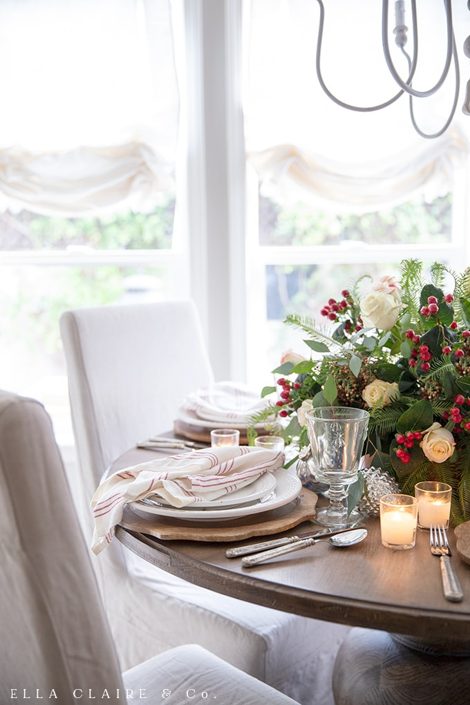 Red striped napkins accent a traditional Christmas Colors table set for entertaining family and holiday guests