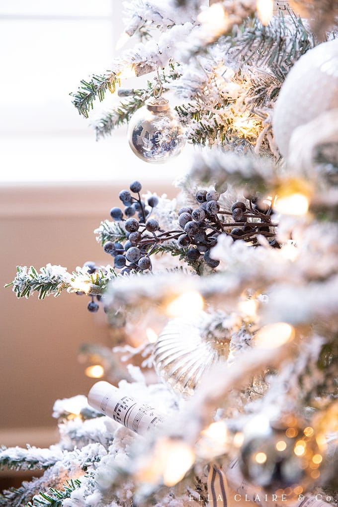 Ble berry sprays are added to this Christmas tree for a little pop of color and texture.