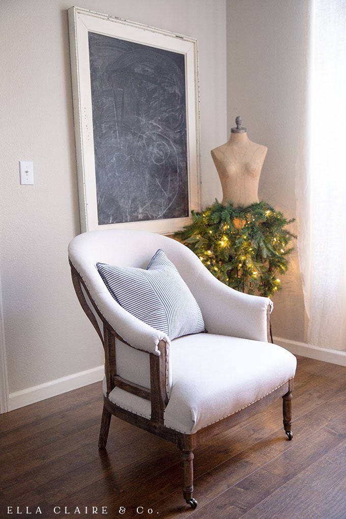 A French chair and a dress form all dressed up for the holidays.