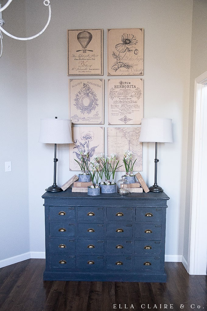 Vintage French prints and paper whites for Christmas in this office space.