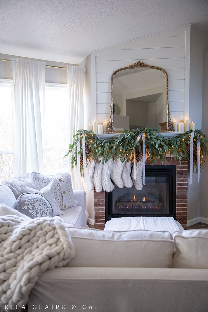 A cozy family room with Traditional Christmas decor and classic elegant vintage accents. Red and Green holiday colors done in an elegant way.