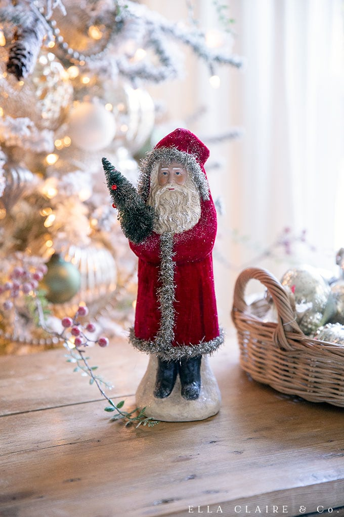 A Vintage santa accents an elegant, traditional Christmas family room decor.