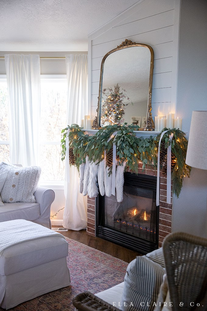 Cozy fire with stockings and an elegant gold mirror