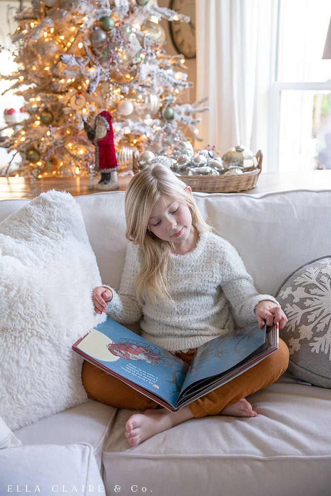 Reading Children's Christmas books by the glow of the Christmas tree.