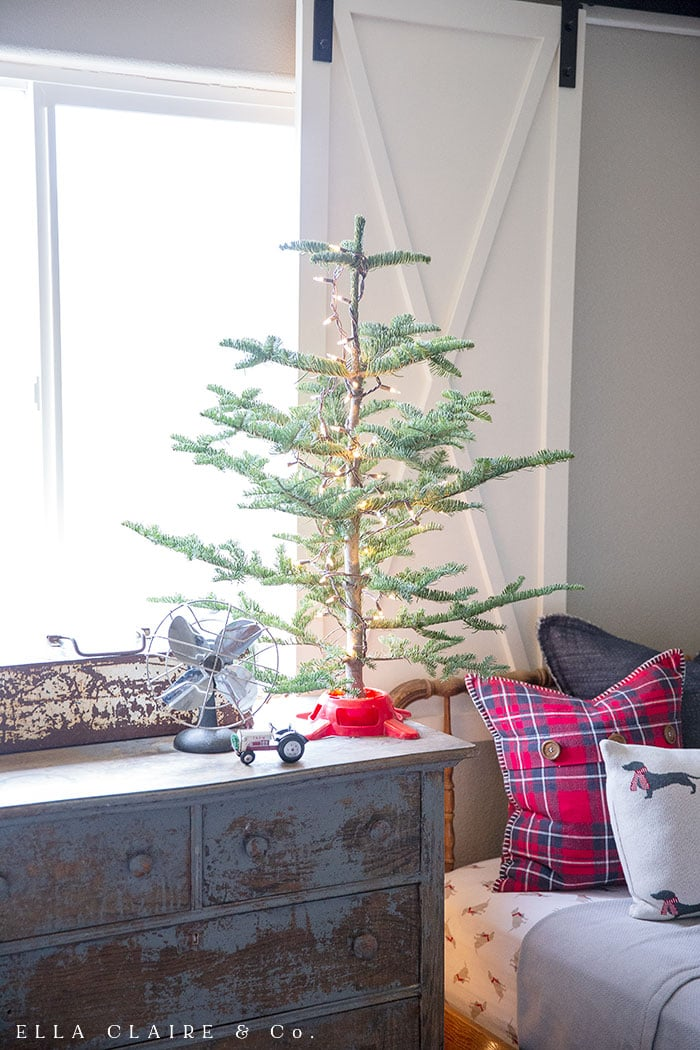 Christmas tree in little boys farmhouse Christmas red and navy blue plaid bedroom