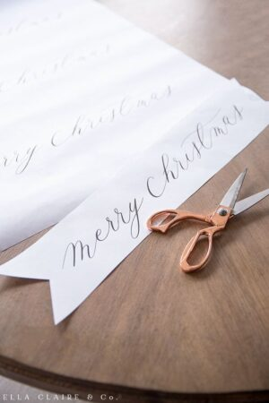 Cut out this free printable Merry Christmas banner, perfect for a Christmas tree decoration, mantel, or wreath accent.