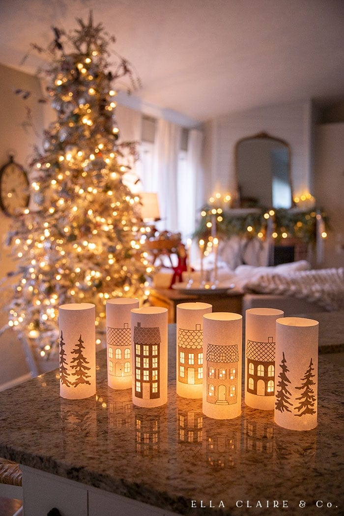 Completely magical and ambient free printable Christmas village luminaries that print out on a single sheet of plain computer paper and dance and sparkle during the magic holiday season.