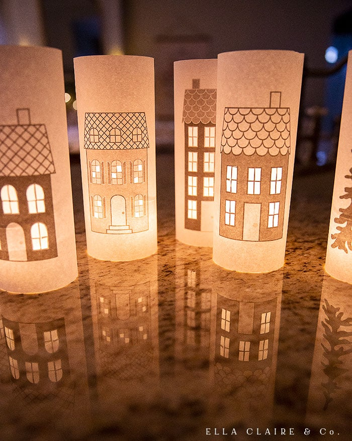 plain computer paper is transformed into beautiful Christmas village luminaries with this free printable
