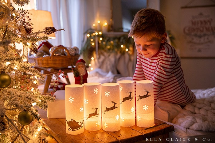 A free printable set of luminaries including santa, his sleigh, and reindeer.
