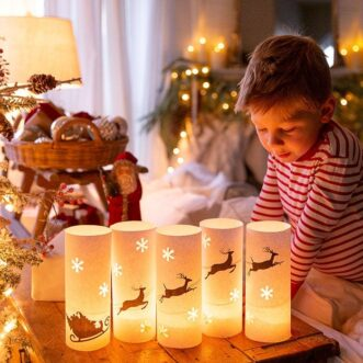 This free printable set of luminaries creates a magical scene with santa in his sleigh flying with his reindeer.