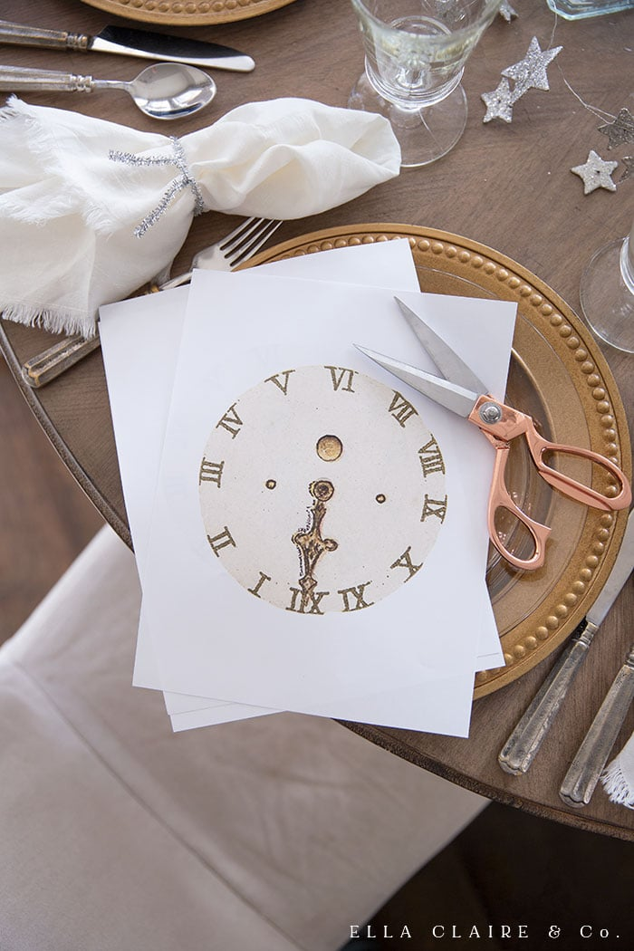 A free printable vintage clock face for New Year's eve entertaining. Place under clear glass plates, place under a centerpiece, or string together to create a banner.