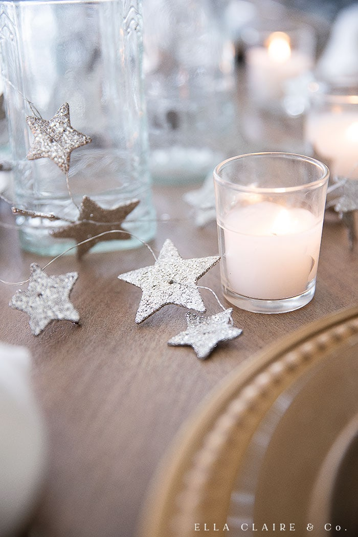 silver glittery stars and candlelight accent this new year's eve tablescape