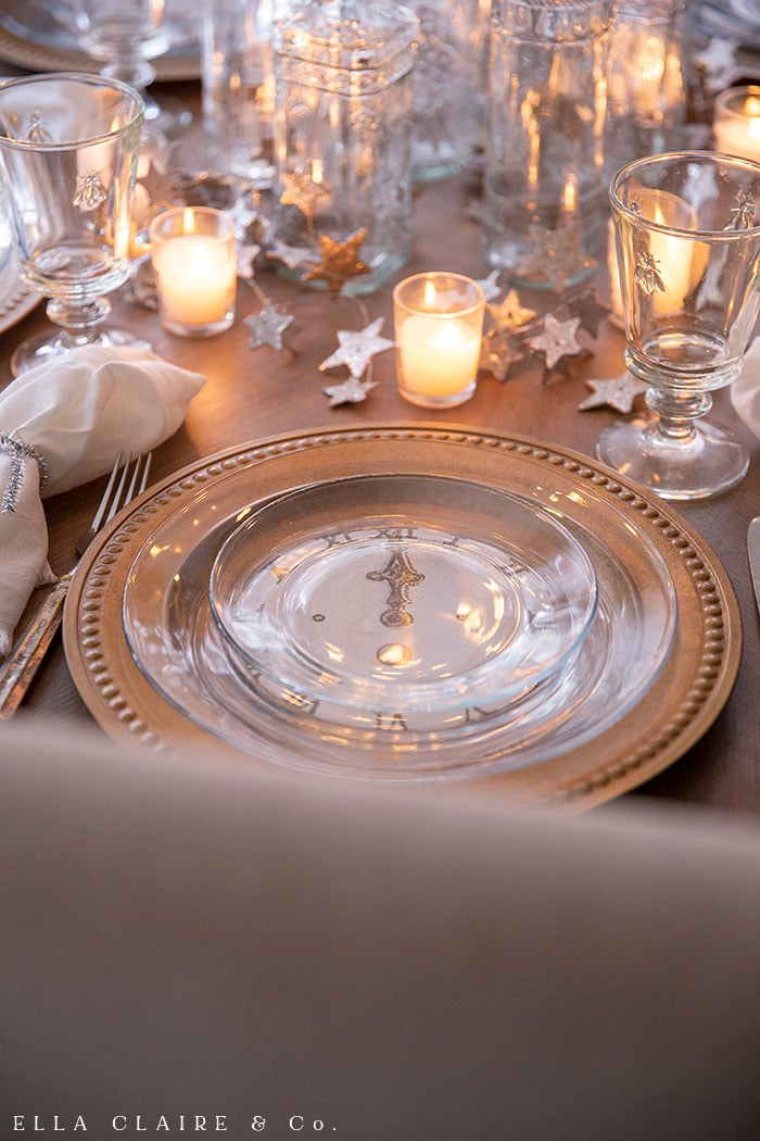 Clear plates atop clock face printables create a nostalgic New Years eve table setting.