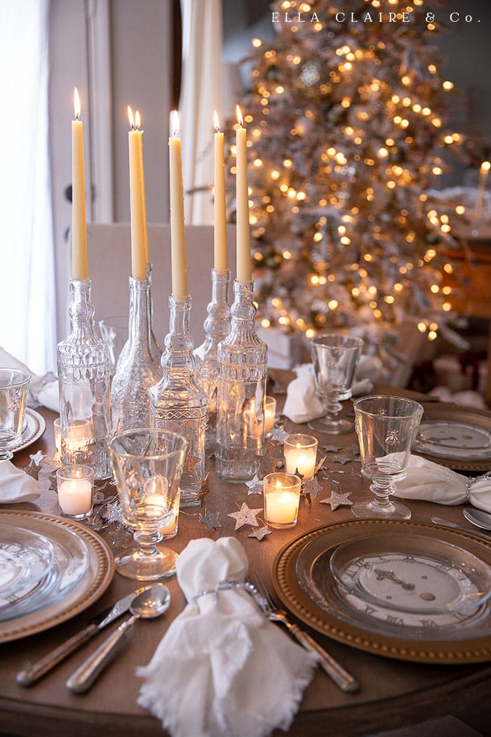 candlelight and vintage clock faces at each place setting create a cozy place for New Years eve entertaining