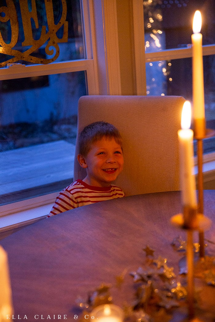 Magical Christmas nights at home with the little ones with twinkle lights, glowing candles and elegant traditional vintage decor.