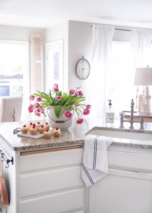 Classic vintage Valentine's Day and Spring decor sprinkled around a Farmhouse kitchen with fresh tulips and raspberry cupcakes.