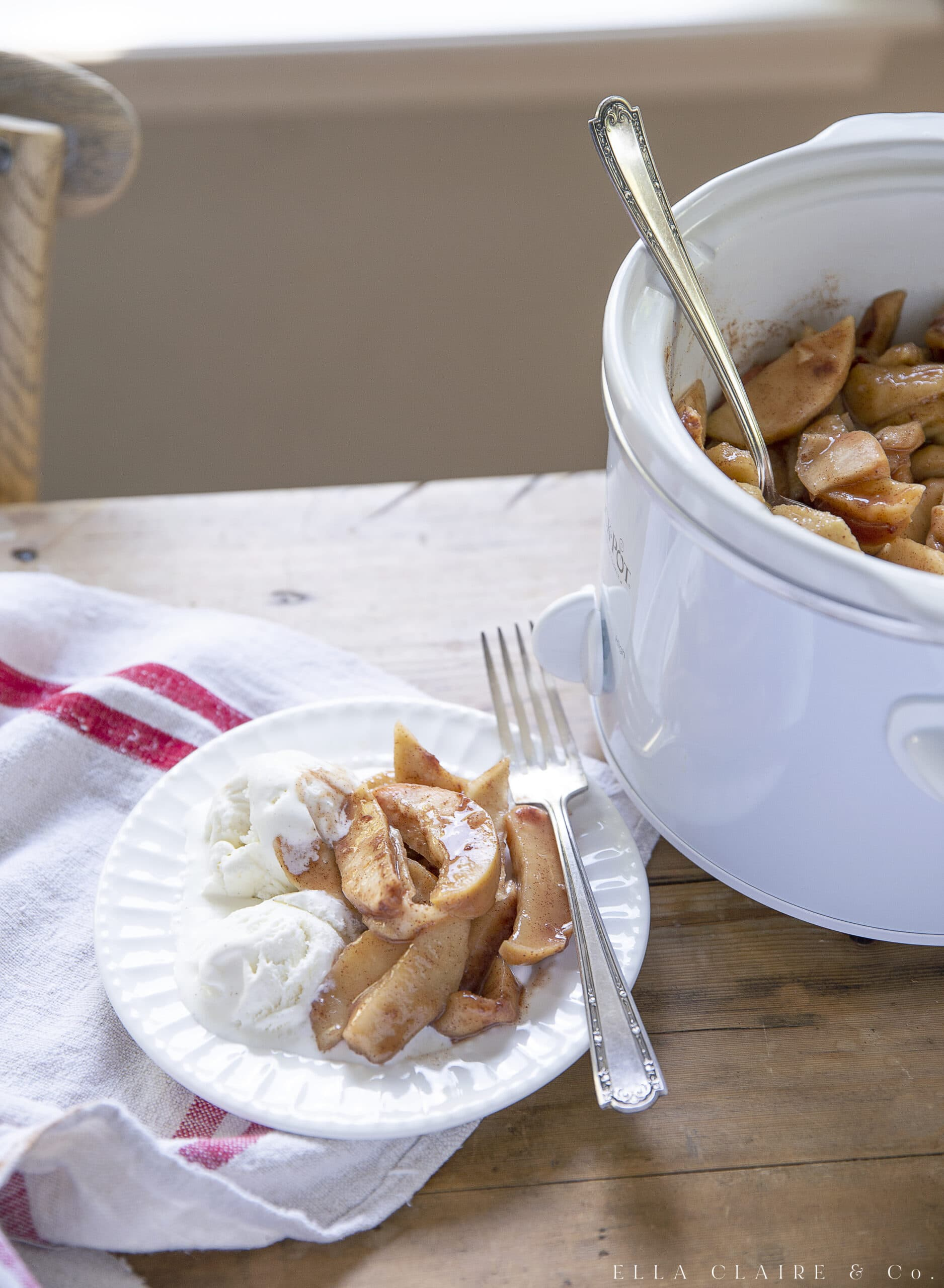 baked cinnamon apples over vanilla ice cream