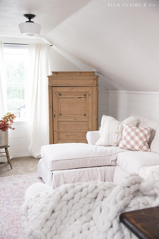 antique pine cabinet in corner