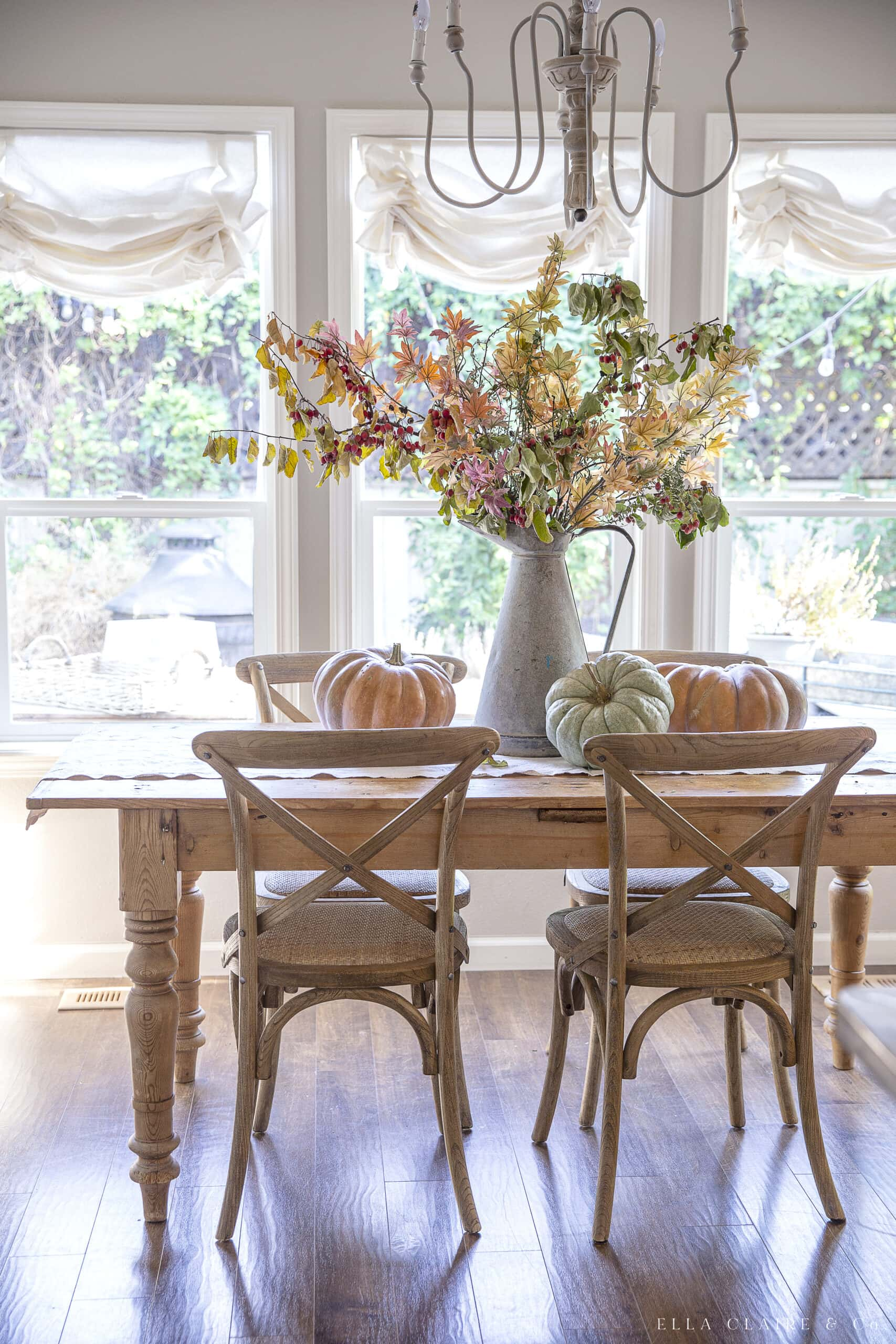 dining room with pumpkins and fall leaves