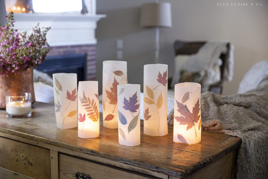 fall leaf luminaries in a row
