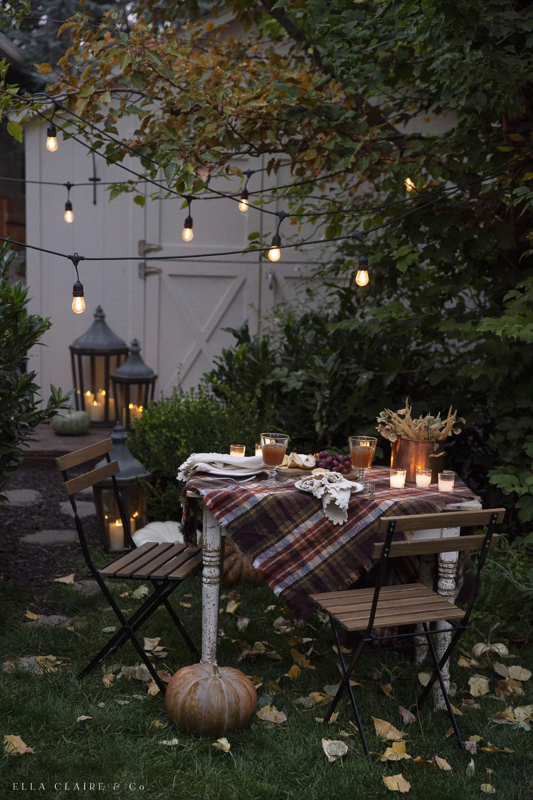 outdoor fall decorations with plaid tablecloth