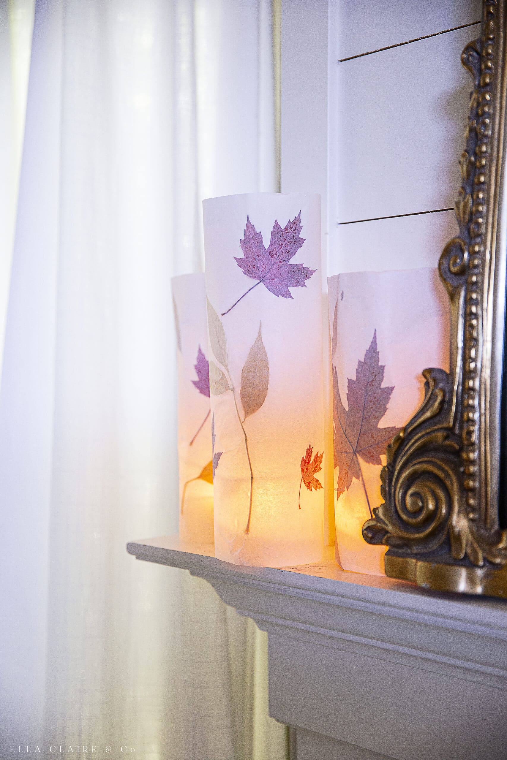 fall leaf luminaries on mantel