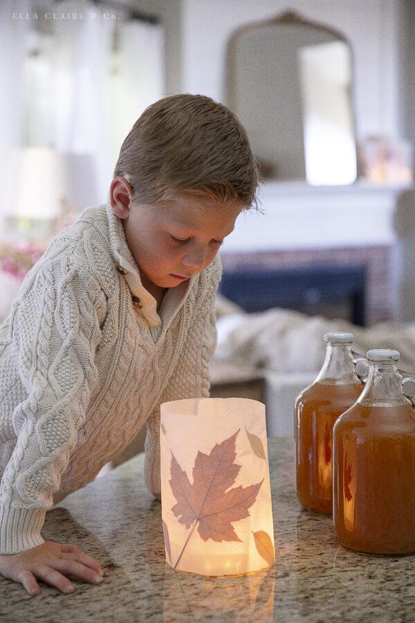 child looking at magical fall luminary