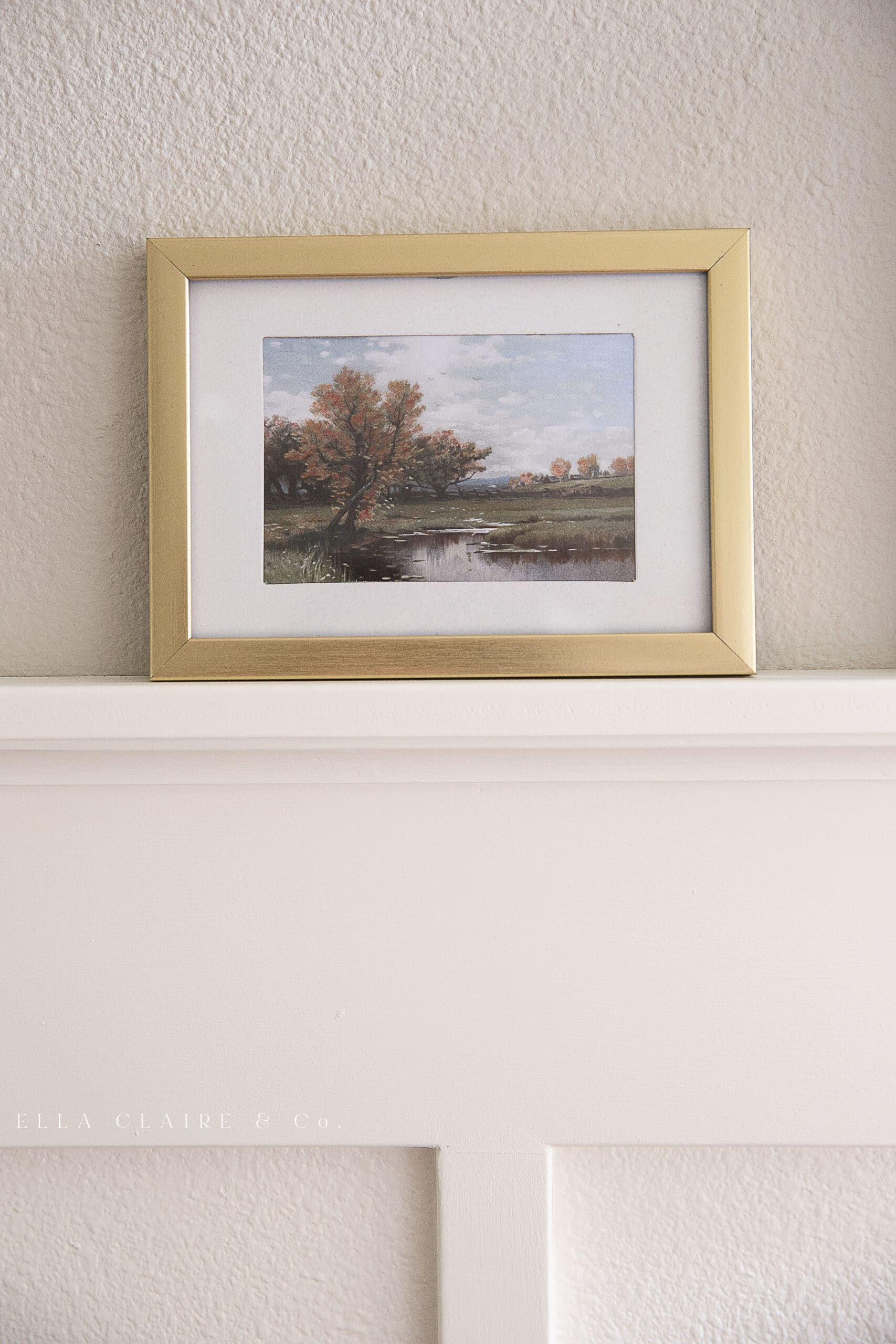 fall landscape printable displayed on millwork