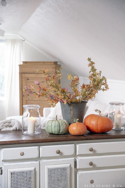 pumpkins and rusty bucket