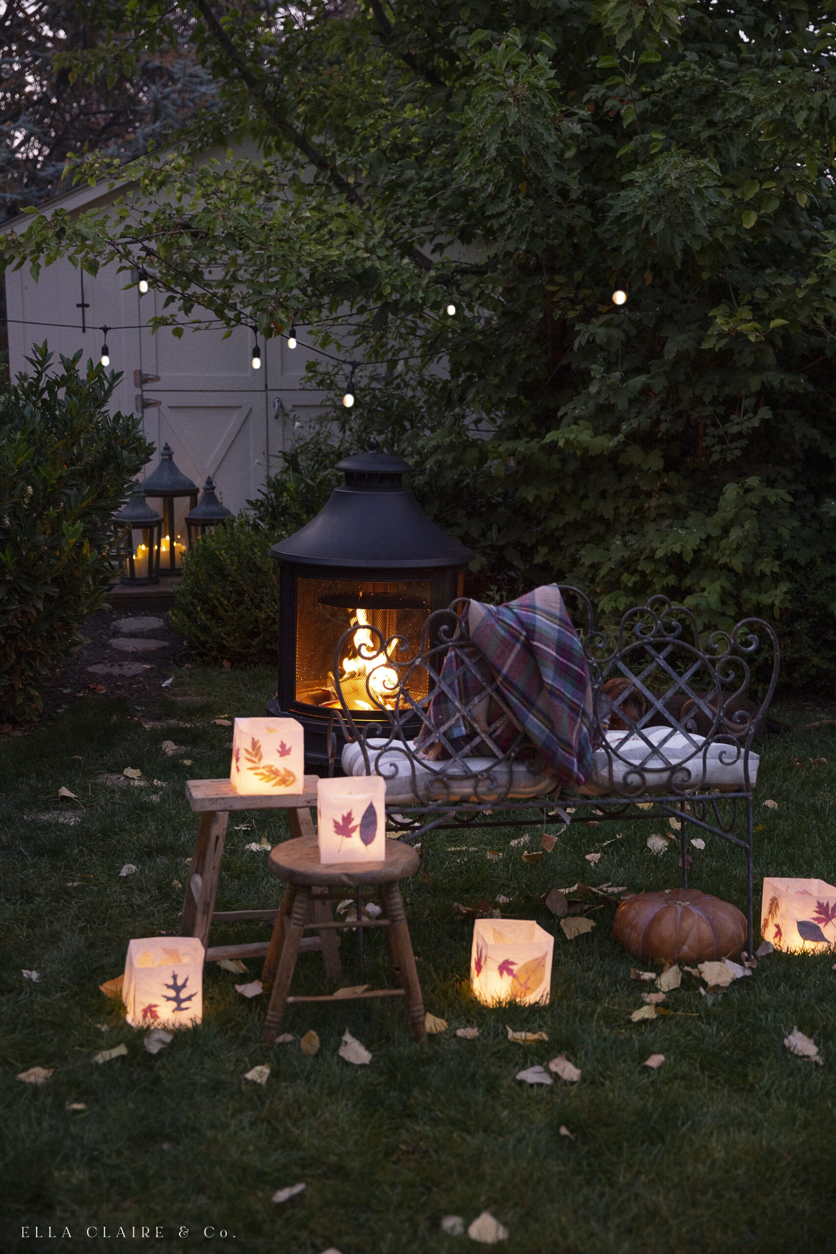 fall fire pit with patio lights, lanterns and luminaries