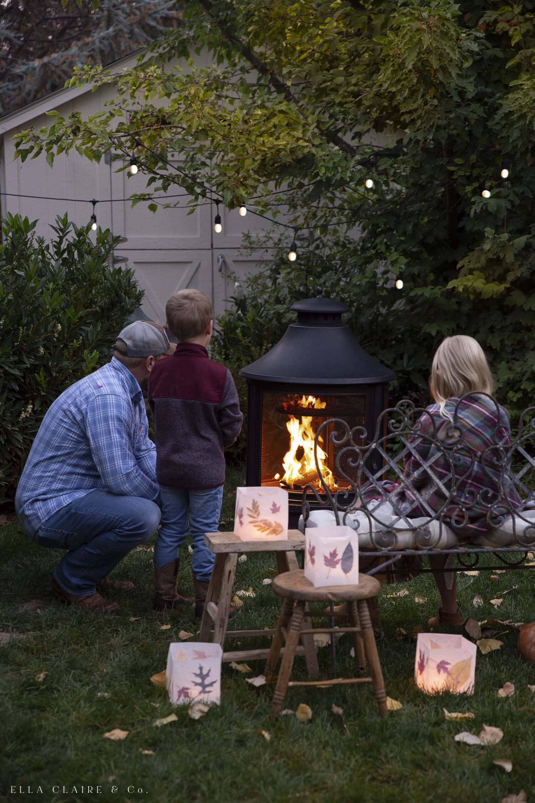 family around backyard campfire