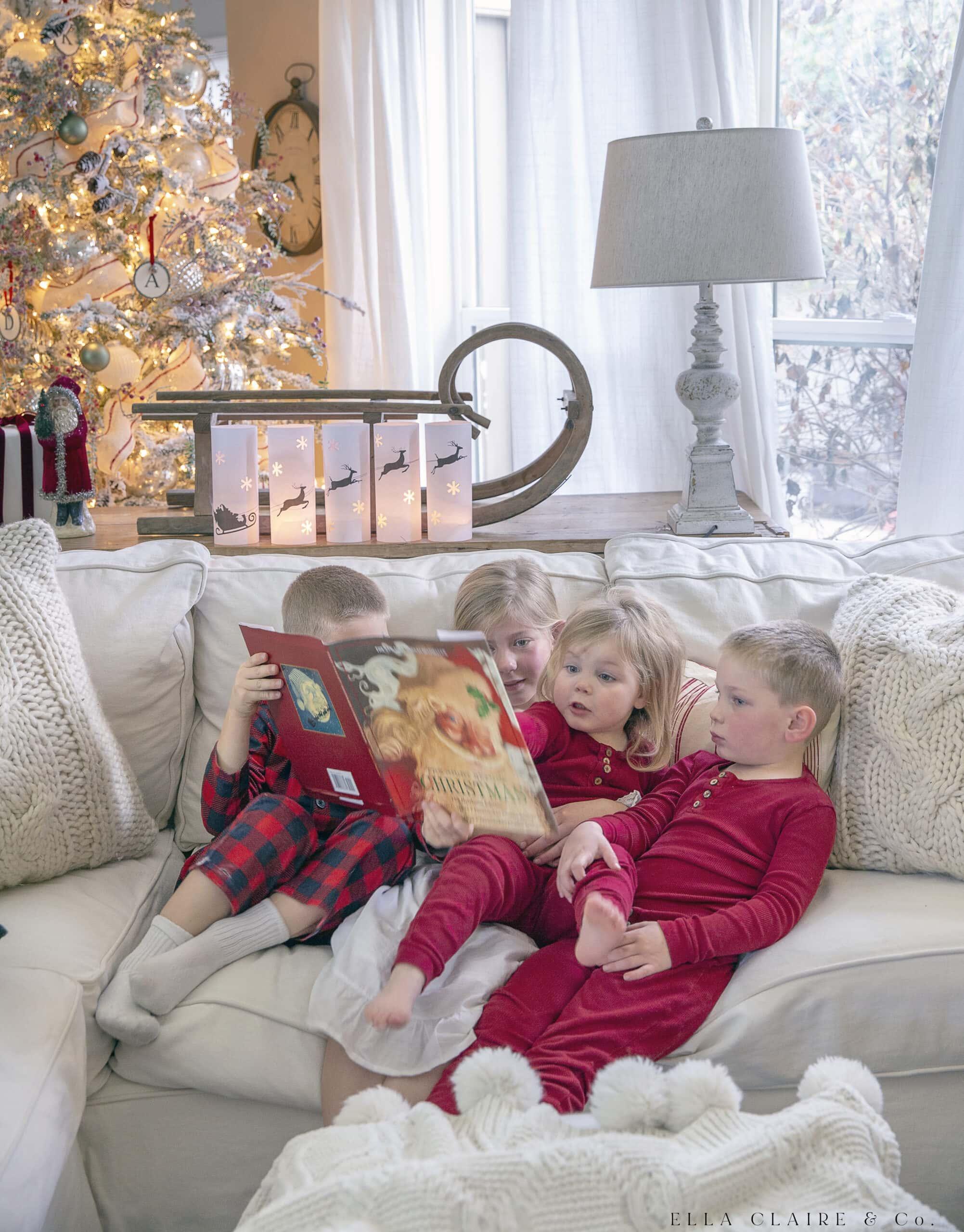 children snuggled reading Christmas Books