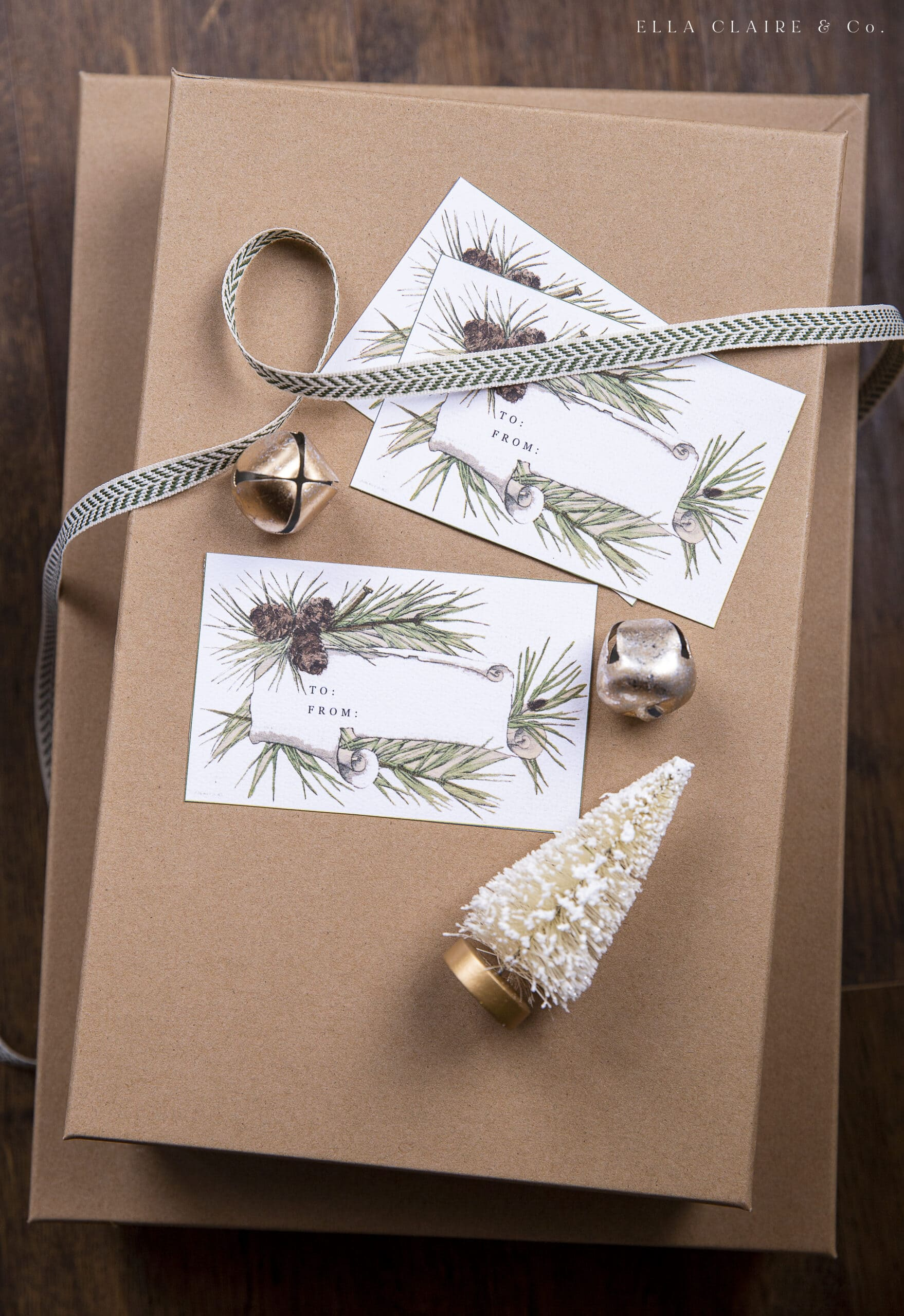 Kraft boxes with pinecone tags and gold bells