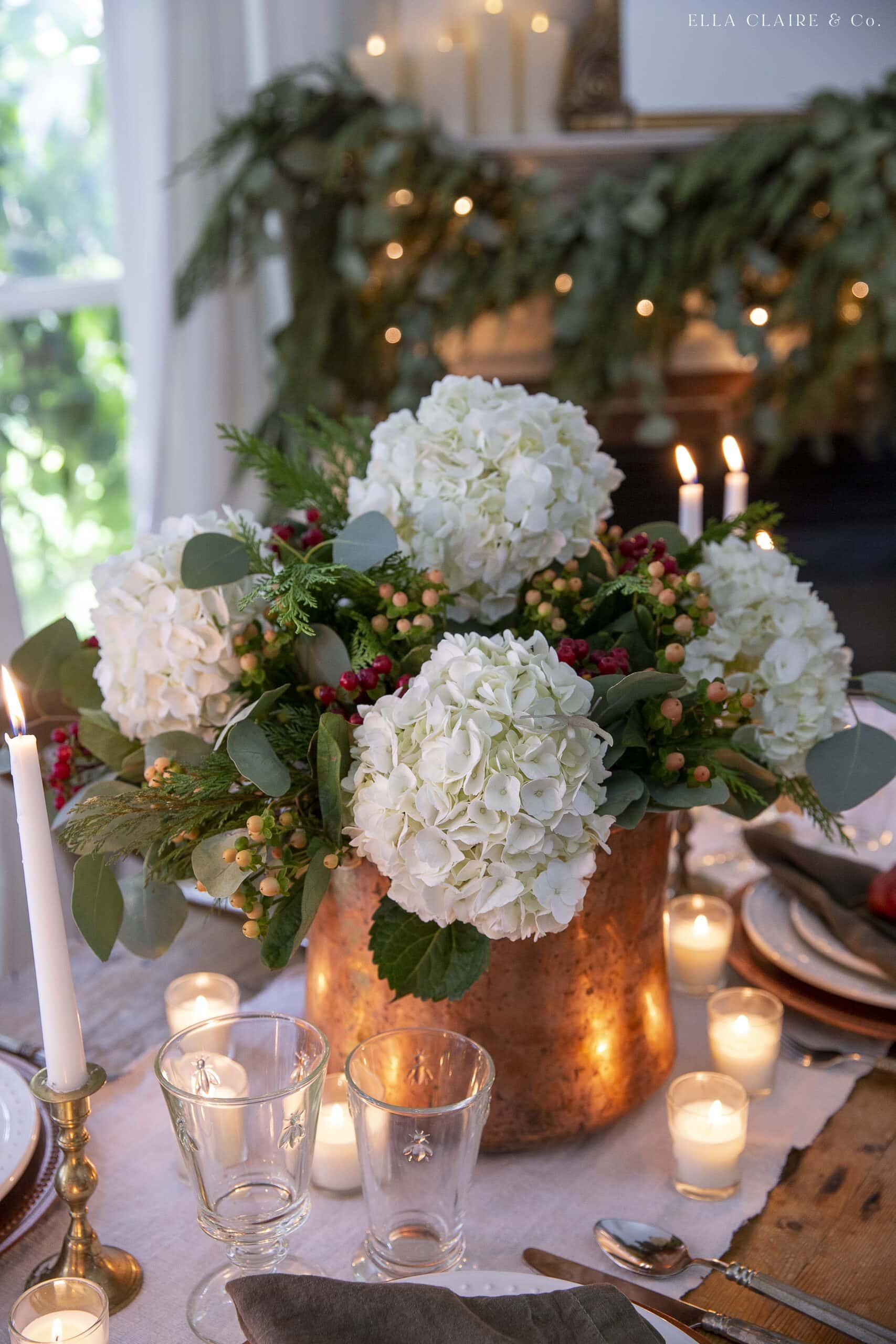 christmas flower arrangement with hydrangeas and berries